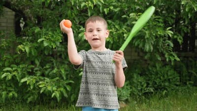 Sports player child boy with racket and ball