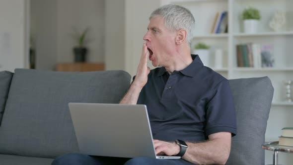 Thumbnail for Sleepy Middle Aged Businessman with Laptop Yawning on Sofa