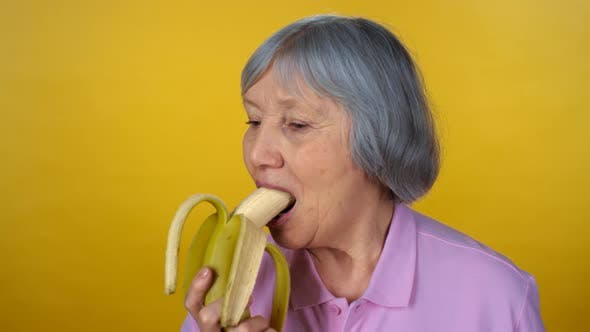 Cover Image for Senior Woman Enjoying Banana