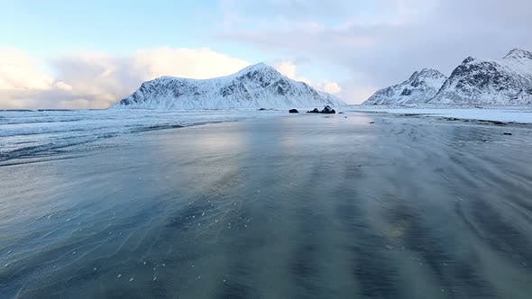 Thumbnail for Surf Wave on the Norwegian Winter Beach Between the Mountains