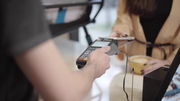 Closeup of Contactless Payment in Cafe
