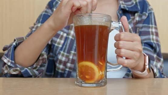 Thumbnail for Woman drink of lemon tea in restaurant