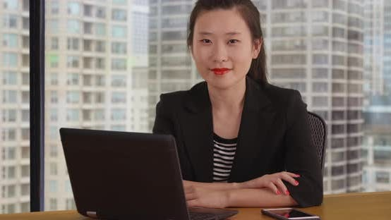 Cover Image for Close up of female accountant working with computer and smartphone in office