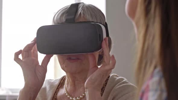 Cover Image for Curious Elderly Woman in VR Goggles