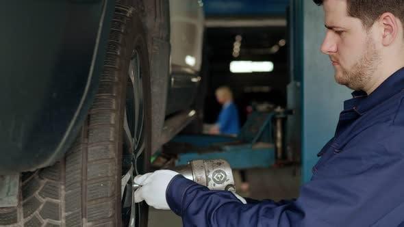 Car Wheel Repair in a Car Workshop