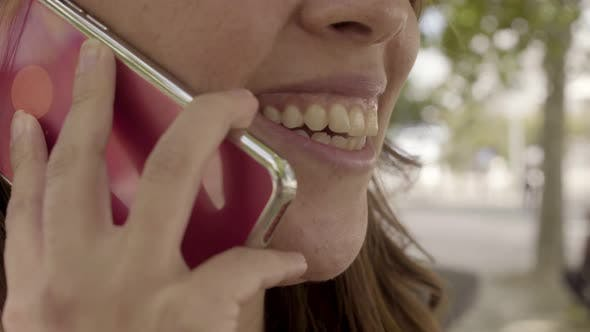 Thumbnail for Young Woman with Toothy Smile Talking on Smartphone