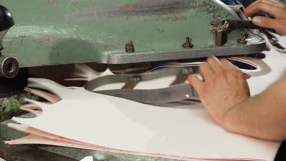 Thumbnail for Craftsman Using Insole Cutting Machine While Making Shoes