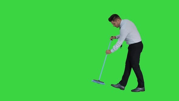 Thumbnail for Man in Official Clother Sweeping the Floor on a Green Screen, Chroma Key