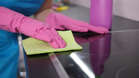 Thumbnail for Hands of Housekeeper Washing Kitchen Stove