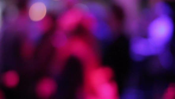 Defocused Gathering of People Dancing, Hanging Out at Nightclub