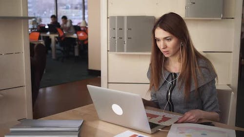 The Woman With Long Red Hair Has Video Call With Client