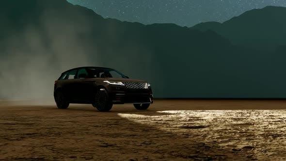 SUV Driving Through Mountain Terrain with Foggy