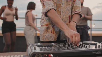 Close Up of DJ Playing at Party