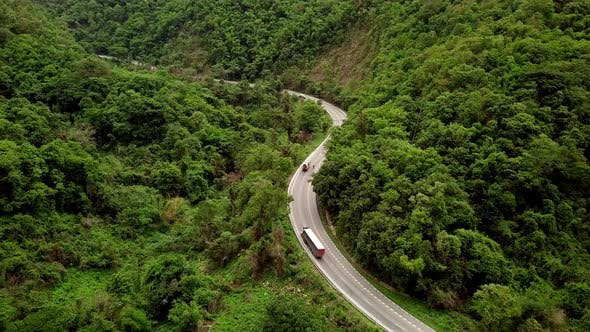 Cover Image for Aerial View Of Countryside Road Passing Through The Mountain Landscape 14