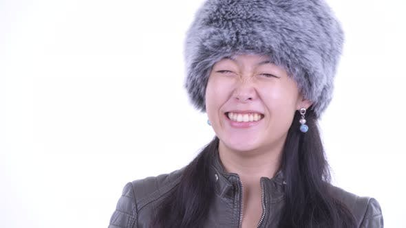 Thumbnail for Face of Happy Beautiful Asian Woman Thinking Ready for Winter