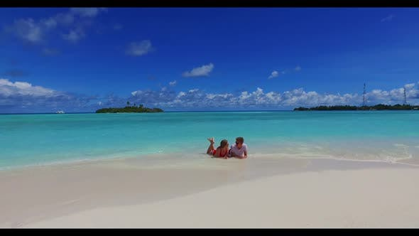 Thumbnail for Two people happy together on luxury coastline beach lifestyle by clear ocean and white sandy backgro