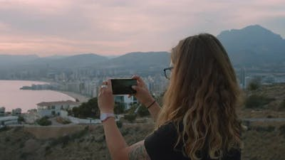 Woman Make Photos of City Landscape View