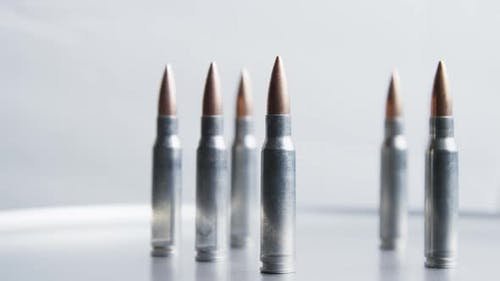 Cinematic rotating shot of bullets on a metallic surface - BULLETS 022