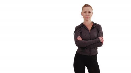 Thumbnail for Serious white female in sportswear posing with determination on white copy space