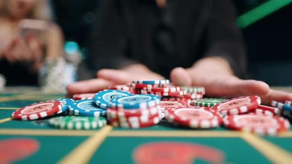 Risky Man Betting All Chips in While Playing in Casino