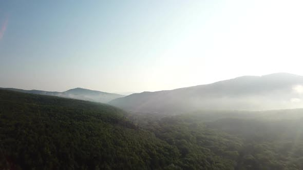 Cover Image for Aerial Landscape View of Caucasus Mountain at Sunny Morning with Fog.