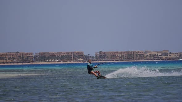 A young woman kite surfing in Egypt.