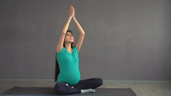 Indian Woman with Hindi. Pregnant Ethnic Girl Engaged in Yoga Sitting in a Lotus Pose.