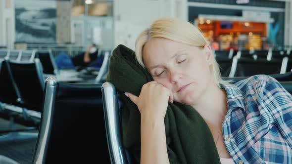 A Young Woman Fell Asleep in the Airport Terminal