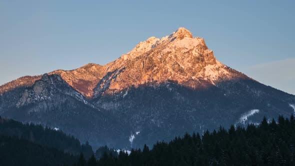 Sunset over Alpine Peak in Winter