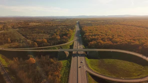 Thumbnail for Aerial View Overpass Traffic with Car Move Transport Background in Autumn