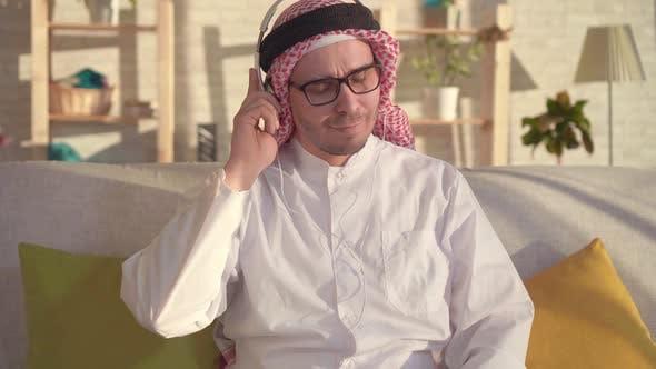 Portrait of Arab Man Listening To Music with Headphones