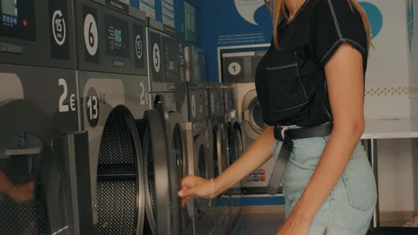 Cover Image for Close Up Woman Hand Opening Washing Machine in Modern Laundry Room