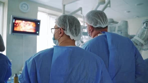 Surgeons Follow the Laparoscopic Surgery on the Screen