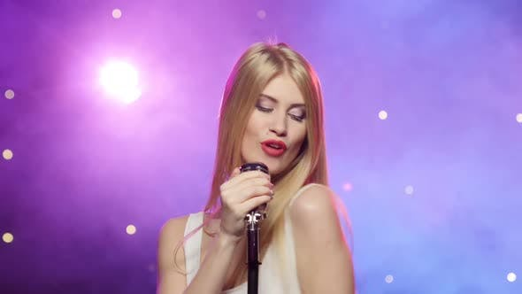 Thumbnail for Blonde Girl Singing Into a Retro Microphone, Strobe Lighting Effect