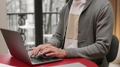 Person Typing on Laptop Computer