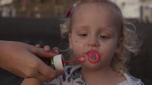 Little Kids Love Blowing Bubbles