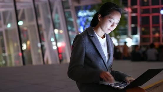 Thumbnail for Businesswoman use of notebook computer at night