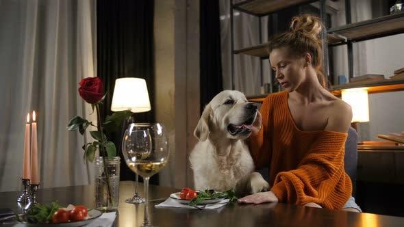 Thumbnail for Elegant Loving Woman Cuddling Her Pet Dog Indoors