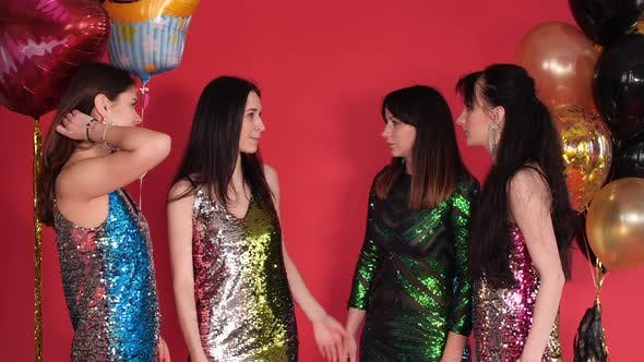 Thumbnail for Group of Women in Beautiful Dresses Having a Conversation and Disagreement