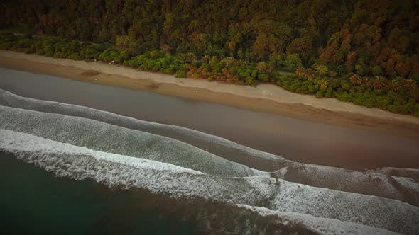 Thumbnail for Aerial view of beach at sunset in Central America.