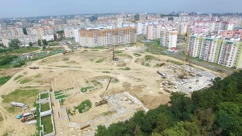 Builders are Working on the Construction of a High Rise Building in the City