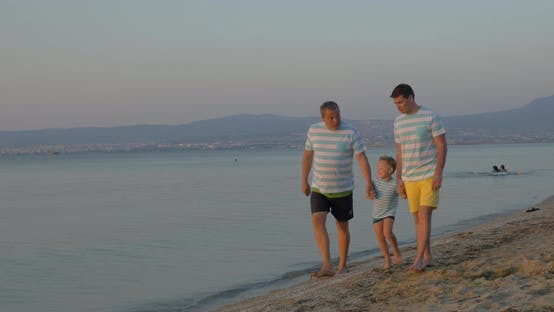Cover Image for Child, Father and Grandfather Walking on the Beach
