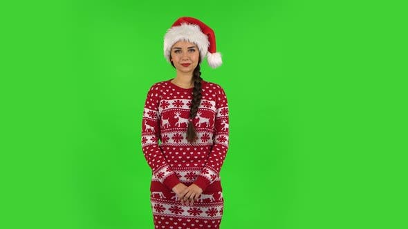 Thumbnail for Sweety Girl in Santa Claus Hat Is Smiling While Looking at Camera. Green Screen