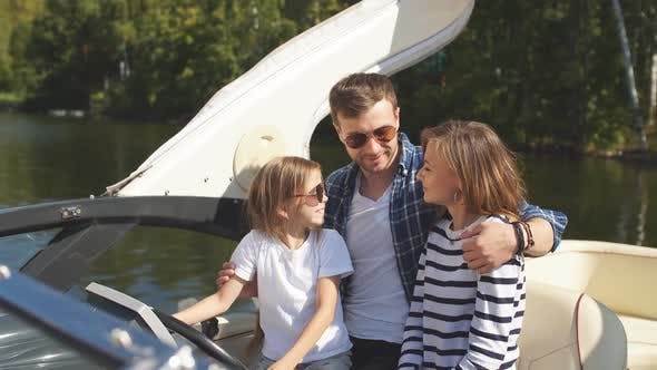 Father with Adorable Daughter and Wife Resting on Big Boat