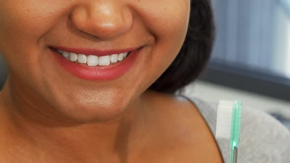 Cover Image for Happy Woman with Perfect Smile Holding Toothbrush Near Her Mouth