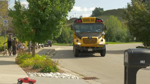 Children getting off from the school bus