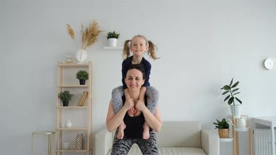 Little Girl with Mother Doing Sport Exercises