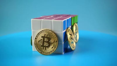 Shining cryptocurrency bitcoin and rubik's cube