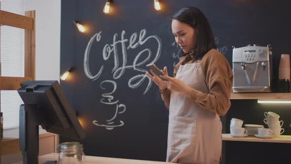 Thumbnail for Coffee Seller Scrolling Feed On Smartphone