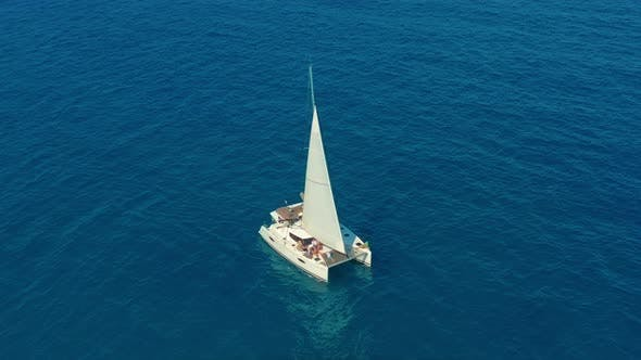 Thumbnail for Aerial View. Large Sailing Catamaran in the Open Sea.